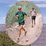 Two runners traveling along the North Kaibab Trail.