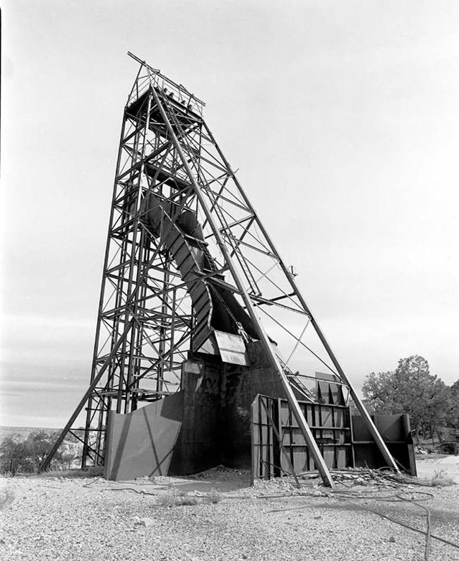 Headframe for mining: tower-like structure composed of wood.