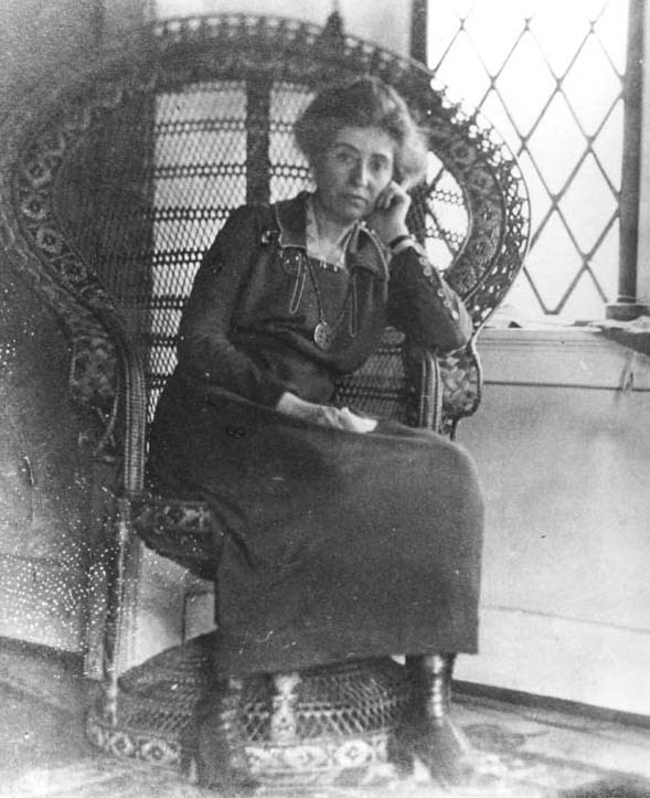 Full shot of Mary Colter in an elaborate wicker chair