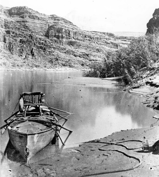 Boat in the Colorado river with a higher chair attached.