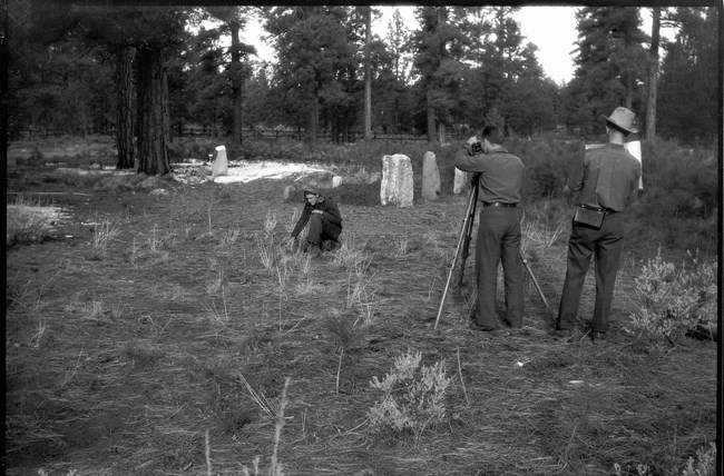 CCC surveying and staking grave plots in the pioneer cemetery.