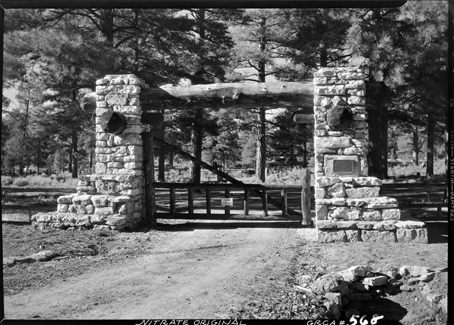 Black and white photo of the pioneer cemetery gate.