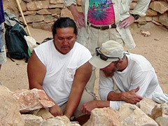 Tribal representative visiting a site.