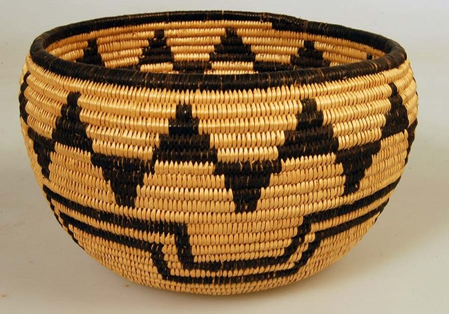 Traditional basket woven of black and tan twine