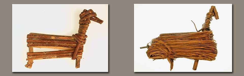 Two split-twig figurines made from willow branches bent into the shape of game animals (left - deer and right sheep)