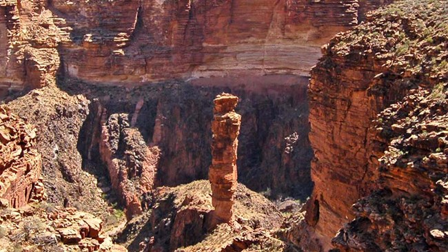 At Monument Creek - A single rock pillar centered on the Grand Canyon landscape.