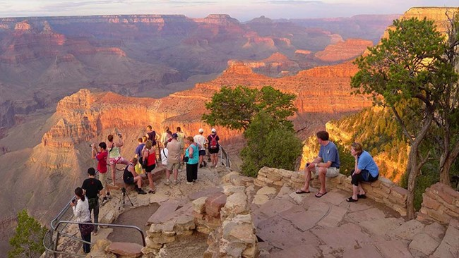 Visitors gather at the Grand Canyon's rim to admire the view.