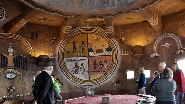 Visitors examining American Indian murals at Desert View Watchtower.