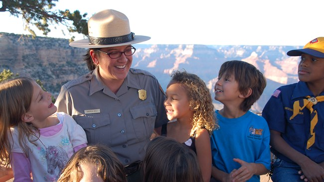An educational ranger interacting with children.