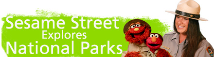 Elmo, Murray and ranger Amala to the right of a green banner that reads - Sesame Street Explores National Parks.