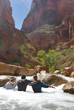 Three youth participants enjoying the waters of Havasu Creek on a 14 day trip in and around Grand Canyon National Park.