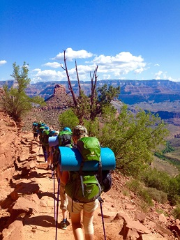 Grand Canyon Expeditions participants backpacking down the Bright Angel Trail.