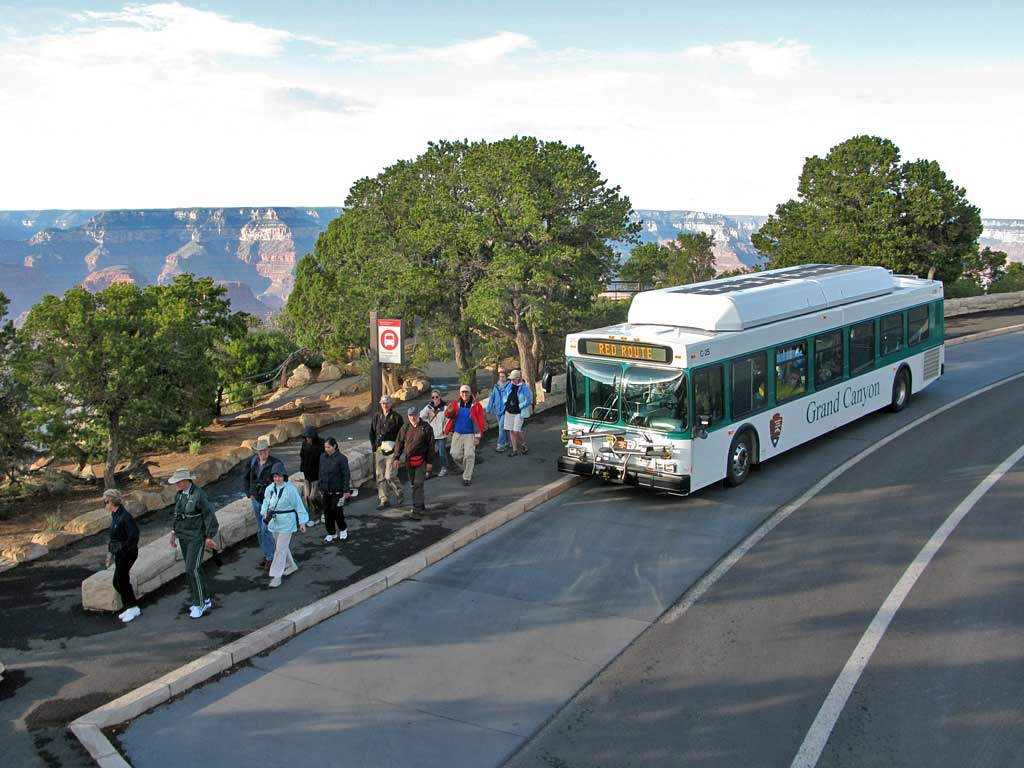 Grand Canyon Shuttle Bus dropping off visitors at Hermits Rest