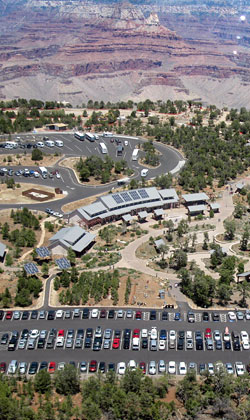Aerial view of Grand Canyon Visitor Center looking north into the Grand Canyon.