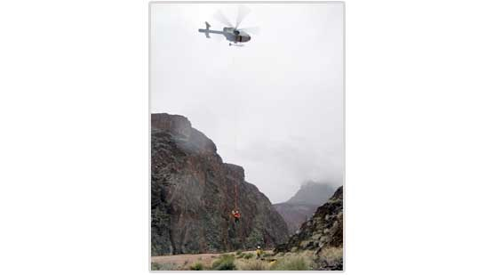 Park helicopter rescues boaters from Crystal Rapid.