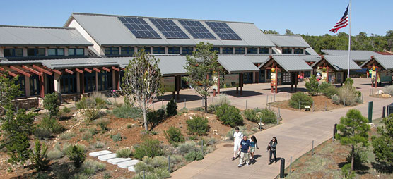 Visitors walking past the S. Rim Visitor Center.
