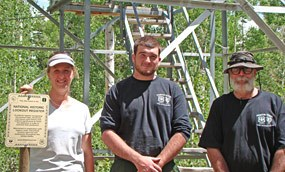 Amy Horn, Archeologist with fire management team members, Jared Fallon (middle) and Fred Adams (right)