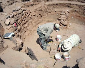 They were uncovering a kiva that had been completely buried by the sand dunes.