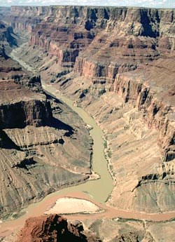 View from rim looking at confluence of Colorado and Little Colorado Rivers. NPS Photo by Tom Bean.