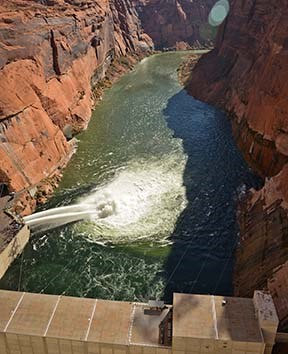 Looking down from Glen Canyon dam during 2012 HFE with tubes open.