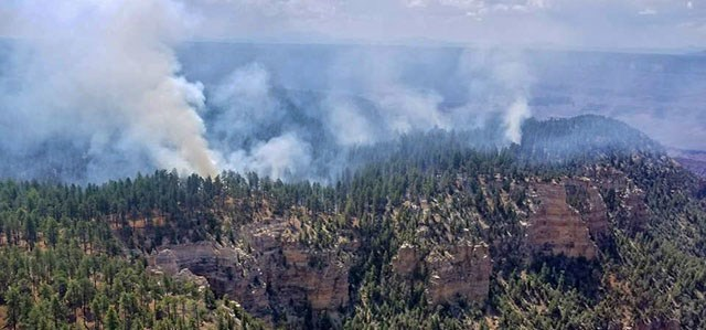 Smoke from several fires burning on a forested plateau above a canyon wall on July 24, 2018.