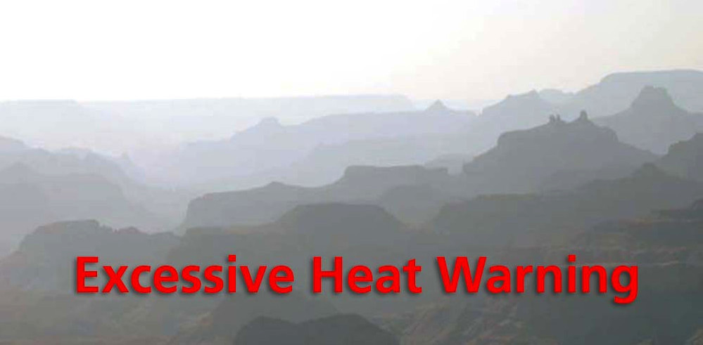 Bright, hazy scene of silhouetted buttes and ridgelines with the words: Excessive Heat Warning across the bottom in red letters.
