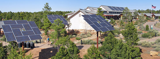 The solar panels for the new photovoltaic system at the Grand Canyon Visitor Center are located both on the Visitor Center roof and on ground-mounted platforms adjacent to the Visitor Center complex.