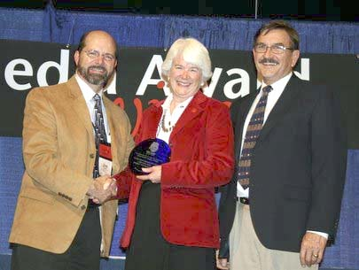 Project Manager Ellen Seeley accepts Grand Canyon's NAI Media Award from NAI President Jim Covel (left) and Executive Director Tim Merriman.