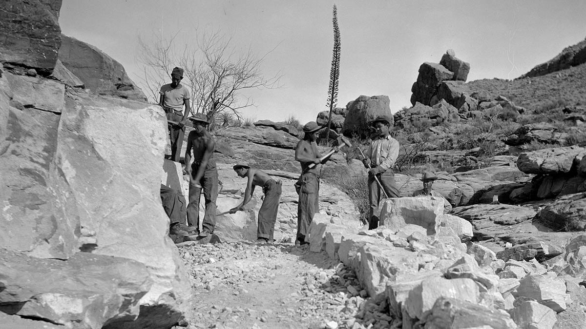 young African American men working on a trail