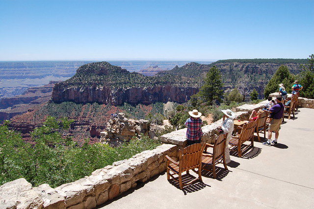 Visitors on porch of Grand Canyon Lodge.