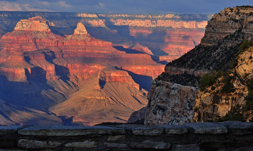 The setting sun casts shadows inside Grand Canyon while looking north