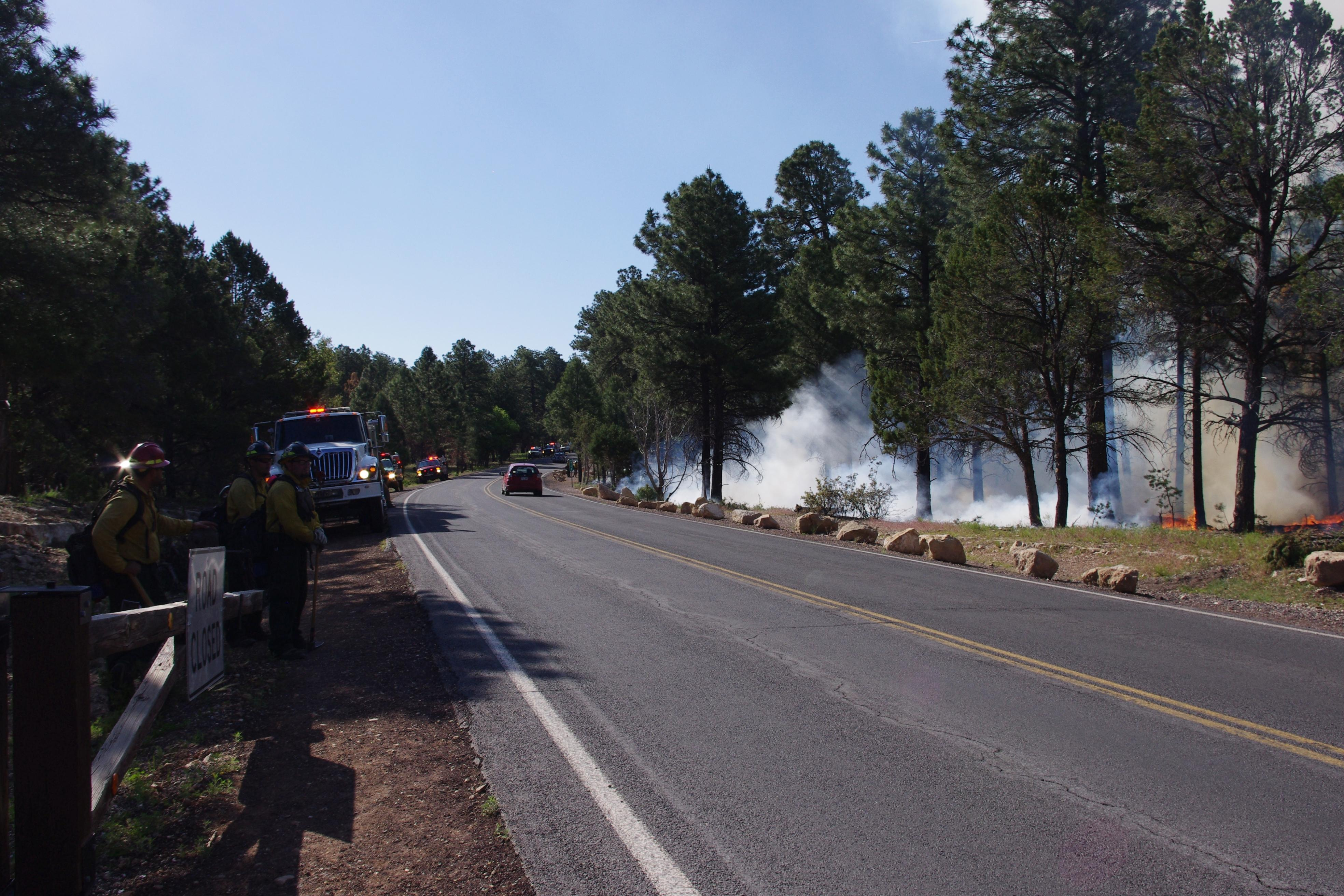 Fire personnel and equipment staged along Highway 64; smoke from Long Jim prescribed fire visible