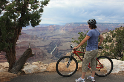 visitor with bike at Grand Canyon