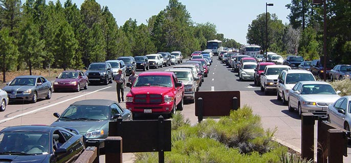 line of vehicles waiting to enter park during a busy holiday weekend