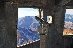Telescope and windows on the observation level of the watchtower.