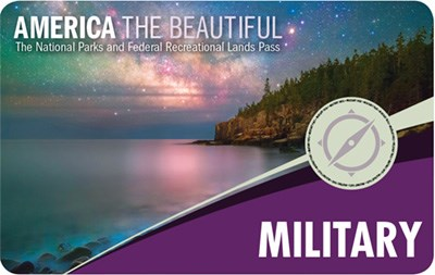 America The Beautiful Military Pass graphic shows rocky, forested shoreline on calm water with Milky Way Galaxy in the sky above.