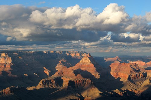Grand Canyon landscape with clouds overhead.