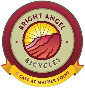 Bright Angel Bicycle Logo shows silhouettes of canyon cliffs within a circle of bicycle wheel spokes.