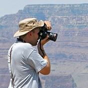 Man photographing the Grand Canyon.