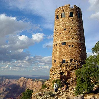 On the edge of a cliff, a circular stone tower 70 feet tall.