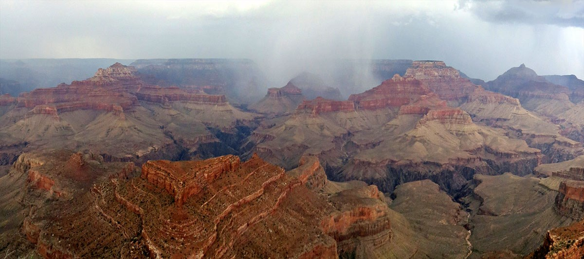 A summer storm passes over the canyon.