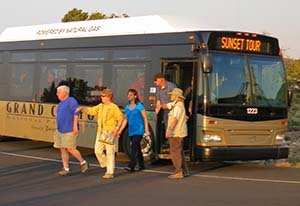 visitors stepping off of a tour bus