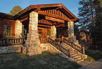 Flight of stairs leads up to front entrance of rustic stone and log North Rim visitor center.