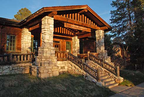 Flight of stairs leads up to front entrance of rustic North Rim visitor center.