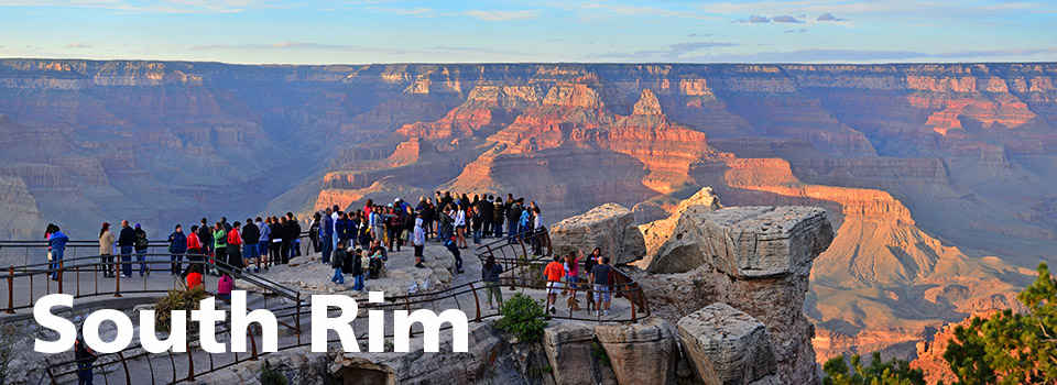 A crowd of people on Mather Point at sunset.