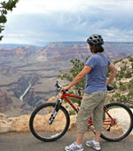 Bicyclist on Hermit Road looking at Colorado River down below.