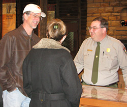 Visitors talking to park ranger at Verkamp's Visitor Center