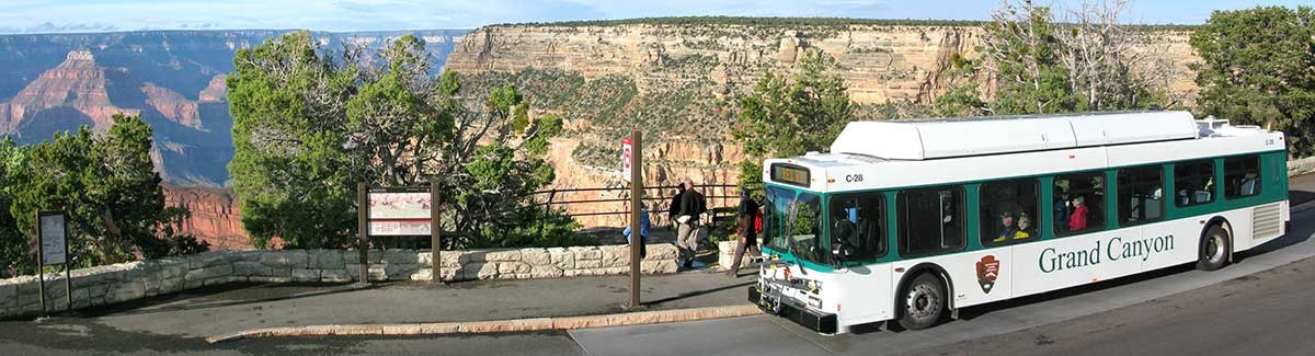 Hermit Road shuttle at Monument Creek Overlook stop. Canyon on left, bus on right.