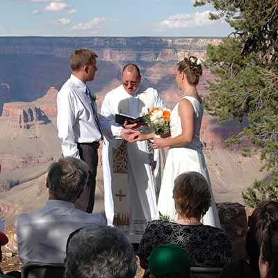 Two people getting married on the rim of Grand Canyon.