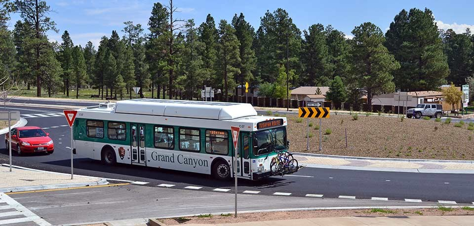 Tusayan Route Park and Ride Shuttle about to arrive in the park's gateway community of Tusayan.